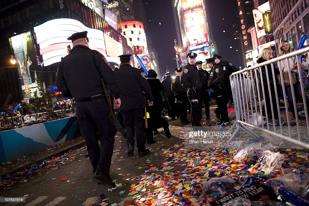 New York Police Department officers walk through Times Square after the annual ball drop January 01, 2011 in New York City. This year a 11,875-pound Waterford crystal ball descended a 141-foot tall flagpole to mark the beginning of 2011.
