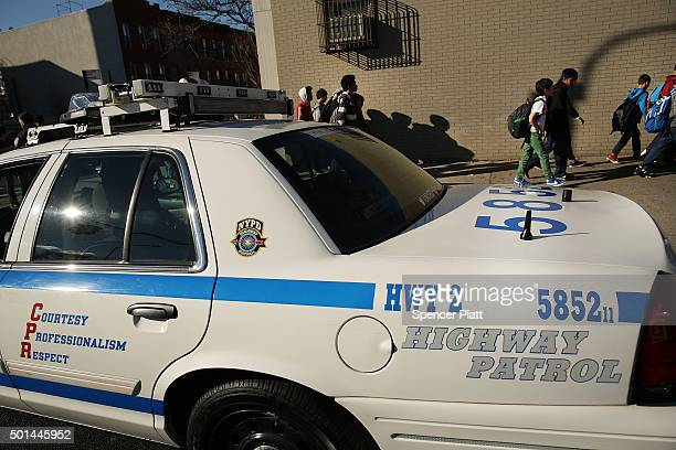 New York Police Department patrol car is parked in front of the Peter Rouget Brooklyn middle school as children are let back in following reports of...