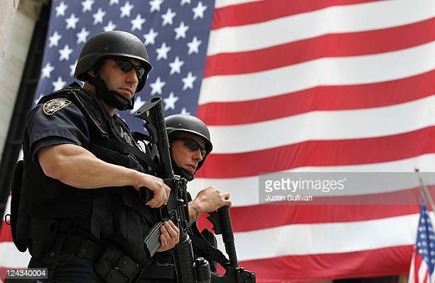 New York Police Department tactical police officers stand guard near the New York Stock Exchange on September 9 2011 in New York City Officials are...