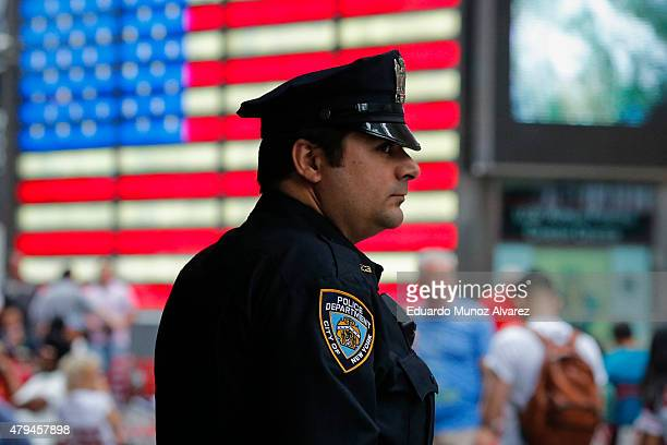 New York Police Officer keeps an eye on tourist as he stands guard at Times Square on July 4 2015 in New York City Security was heightened with more...