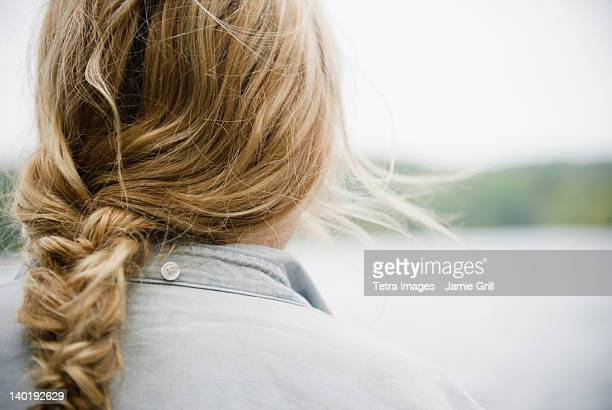 USA, New York, Putnam Valley, Roaring Brook Lake, Close up of woman's blond and braided hair