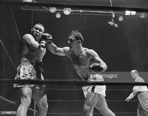 Putting A Period To Louis Career Graphically caught by the camera here are two telling blows that helped write the finale of Joe Louis' ring career...