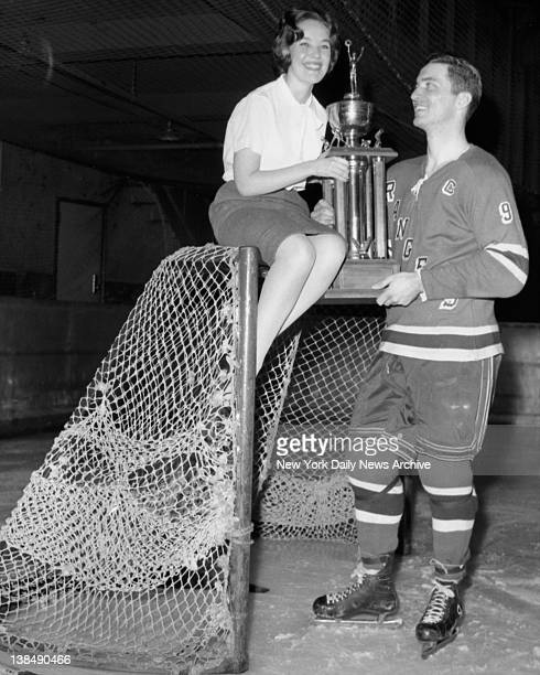 New York Ranger captain Andy Bathgate receives the Frank Boucher Trophy from Ranger Fan Club member Barbara Grace at Iceland on Hillside Ave in New...