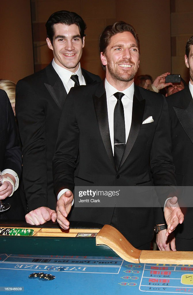 New York Rangers Brian Boyle and <a gi-track='captionPersonalityLinkClicked' href=/galleries/search?phrase=Henrik+Lundqvist&family=editorial&specificpeople=217958 ng-click='$event.stopPropagation()'>Henrik Lundqvist</a> play craps with fans at the 2013 New York Rangers Casino Night at Gotham Hall on March 1, 2013 in New York City.