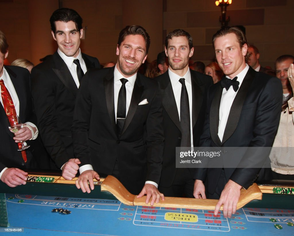 New York Rangers Brian Boyle, <a gi-track='captionPersonalityLinkClicked' href=/galleries/search?phrase=Henrik+Lundqvist&family=editorial&specificpeople=217958 ng-click='$event.stopPropagation()'>Henrik Lundqvist</a>, Dan Girardi and <a gi-track='captionPersonalityLinkClicked' href=/galleries/search?phrase=Brad+Richards&family=editorial&specificpeople=202622 ng-click='$event.stopPropagation()'>Brad Richards</a> play craps with fans at the 2013 New York Rangers Casino Night at Gotham Hall on March 1, 2013 in New York City.