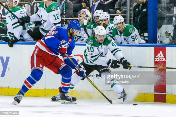 New York Rangers Center Boo Nieves and Dallas Stars Left Wing Remi Elie fight for puck during the Dallas Stars and New York Rangers NHL game on...