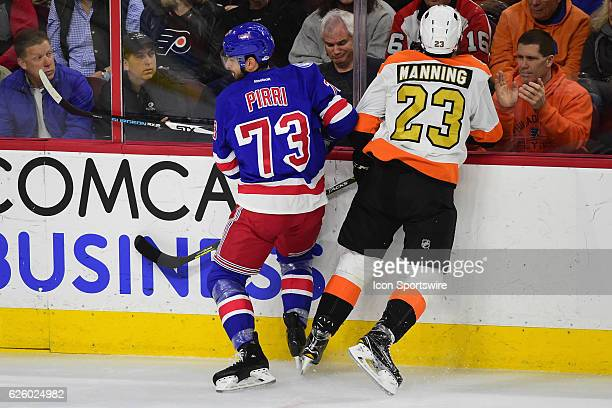 New York Rangers Center Brandon Pirri boards Philadelphia Flyers Defenceman Brandon Manning during a National Hockey League game between the New York...