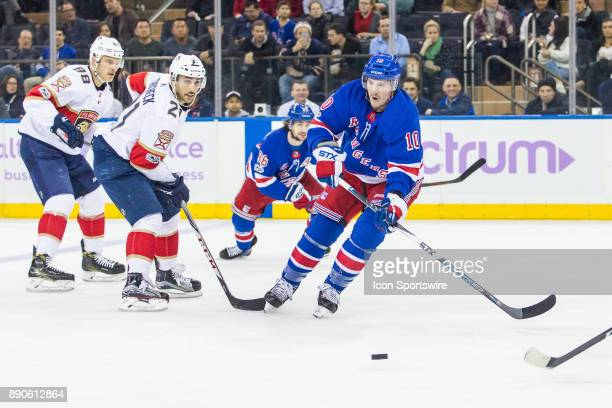 New York Rangers Center JT Miller passes the puck during the first period of a regular season NHL game between the Florida Panthers and the New York...