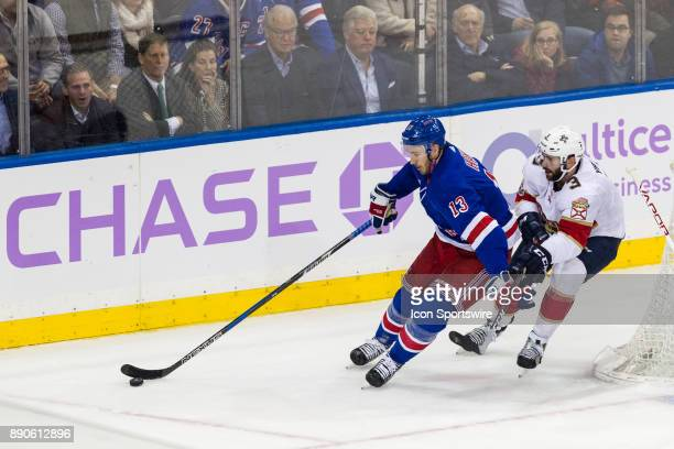 New York Rangers Center Kevin Hayes takes the puck out from behind the net during the second period of a regular season NHL game between the Florida...