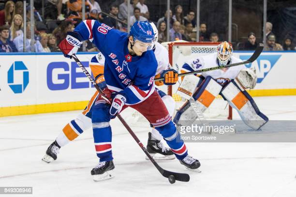 New York Rangers Center Lias Andersson works the puck in the Islanders zone during the third period of a preseason NHL game between the New York...