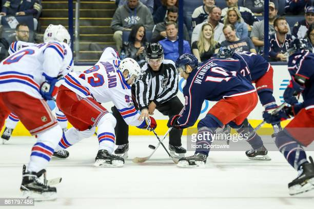 New York Rangers center Mika Zibanejad and Columbus Blue Jackets center Alexander Wennberg faceoff during the first period in a game between the...