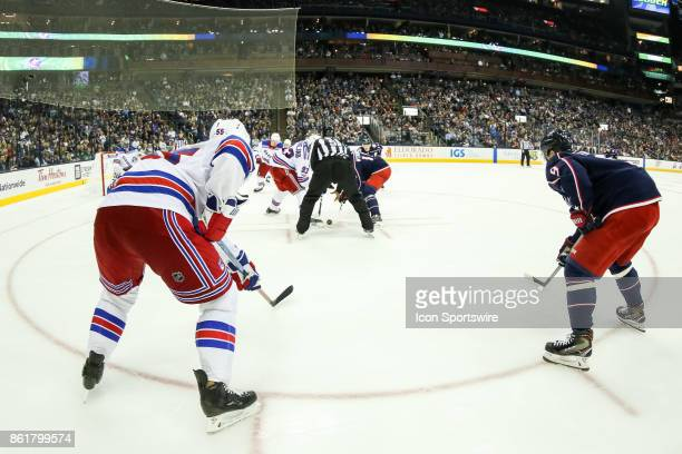 New York Rangers center Mika Zibanejad and Columbus Blue Jackets center Alexander Wennberg faceoff during the third period in a game between the...