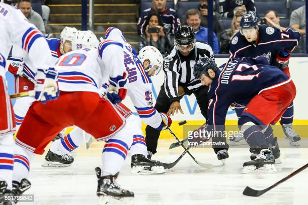 New York Rangers center Mika Zibanejad and Columbus Blue Jackets center Brandon Dubinsky faceoff during the third period in a game between the...