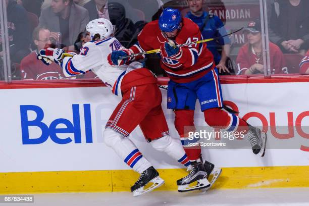 New York Rangers center Mika Zibanejad being check by Montreal Canadiens right wing Alexander Radulov during the first period of Game One of the...