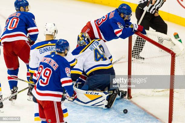 New York Rangers Center Mika Zibanejad crashes into the net after scoring during the first period of a regular season NHL game between the St Louis...