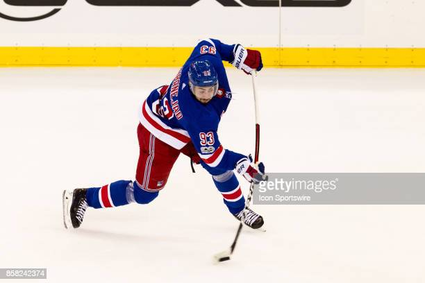 New York Rangers Center Mika Zibanejad fires a shot on goal during the first period of the New York Rangers home opener against the Colorado...