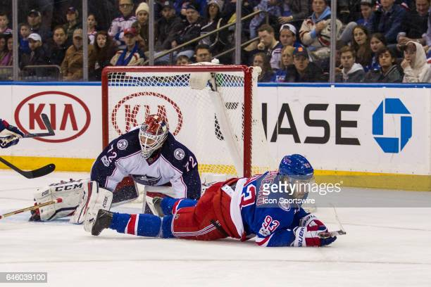 New York Rangers Center Mika Zibanejad slides across the ice as Columbus Blue Jackets Goalie Sergei Bobrovsky gets called for tripping during the...