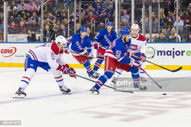 New York Rangers Center Mika Zibanejad works the puck across the blue line during the first period of a regular season NHL game between the Montreal...