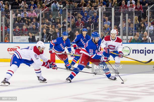 New York Rangers Center Mika Zibanejad works the puck into the Canadiens zone during the first period of a regular season NHL game between the...