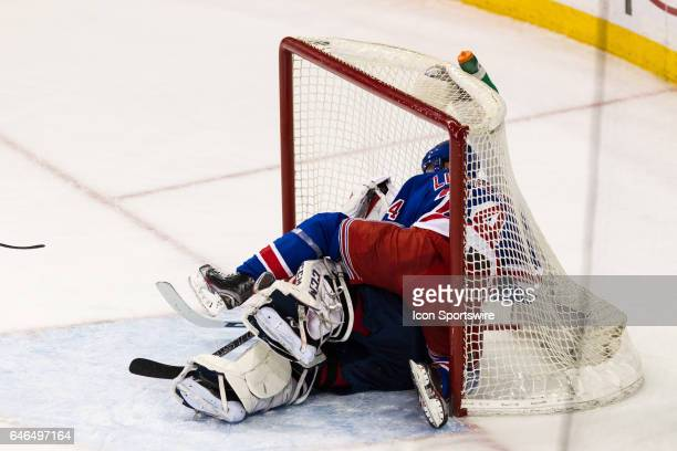 New York Rangers Center Oscar Lindberg crashes into Washington Capitals Goalie Braden Holtby and both fly into the Capitals net during the first...
