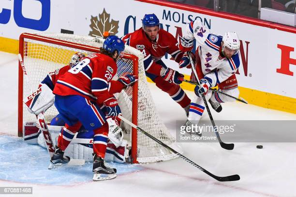 New York Rangers center Oscar Lindberg going around Montreal Canadiens goalie Carey Price net chased by Montreal Canadiens defenseman Alexei Emelin...