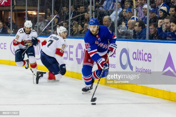 New York Rangers Defenceman Kevin Shattenkirk works the puck behind the net during the third period of a regular season NHL game between the Florida...