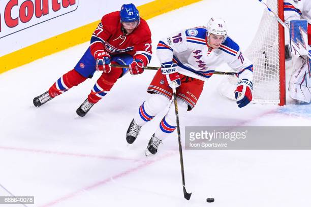 New York Rangers defenseman Brady Skjei skating away pursued by Montreal Canadiens center Alex Galchenyuk during game 2 of the first round of the...