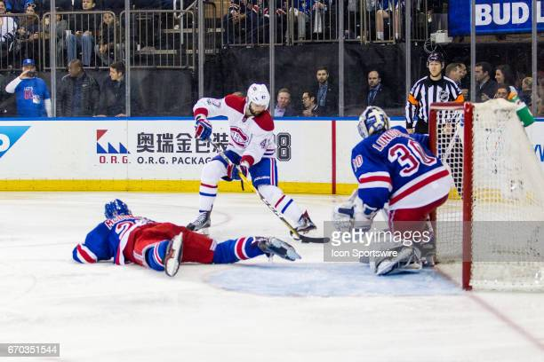 New York Rangers defenseman Ryan McDonagh slides across the ice blocking a centering pass by Montreal Canadiens right wing Alexander Radulov during...