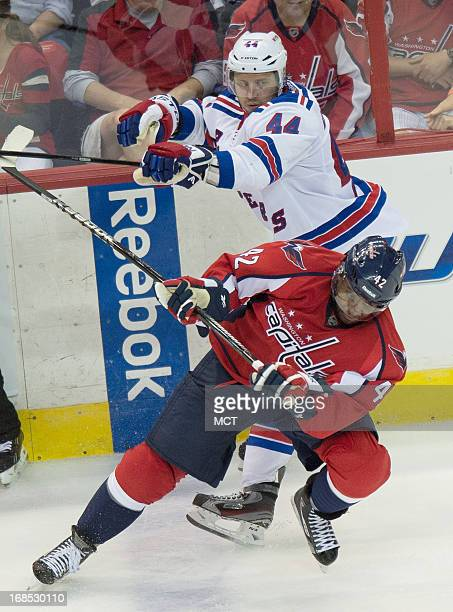 New York Rangers defenseman Steve Eminger knocks Washington Capitals right wing Joel Ward to the ice in the third period of Game 5 of the NHL Eastern...