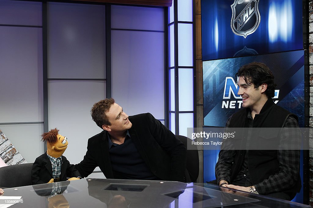 New York Rangers forward Brian Boyle, actor Jason Segel and his THE MUPPETS movie co-star, Walter, on the set of Cisco NHL Live! at the NHL Powered by Reebok store on November 21, 2011 in New York City.