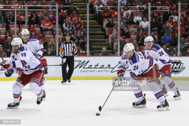 New York Rangers forward Oscar Lindberg of Sweden skates with the puck during the third period of a regular season NHL hockey game between the New...