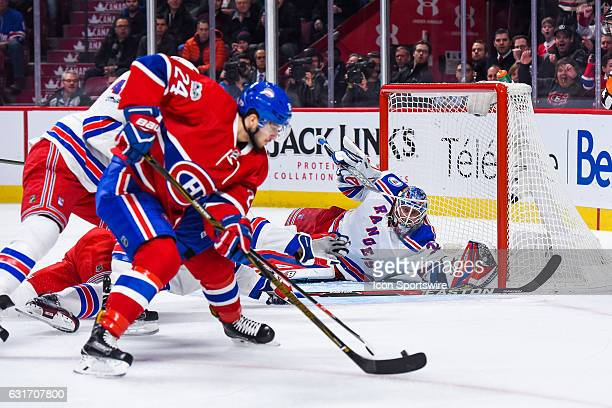 New York Rangers Goalie Antti Raanta watching the puck Montreal Canadiens Center Phillip Danault is about to shoot on him the goal was refused during...