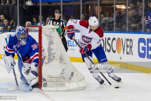 New York Rangers goalie Henrik Lundqvist looks on as Montreal Canadiens center Alex Galchenyuk takes the puck out from behind the net during the...
