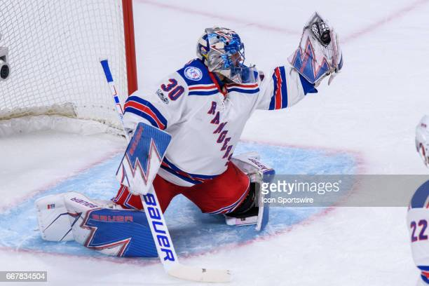New York Rangers goalie Henrik Lundqvist makes a glove save during the first period of Game One of the Eastern Conference First Round series of the...