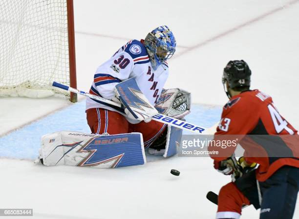 New York Rangers goalie Henrik Lundqvist makes a third period save against Washington Capitals right wing Tom Wilson on April 5 at the Verizon Center...
