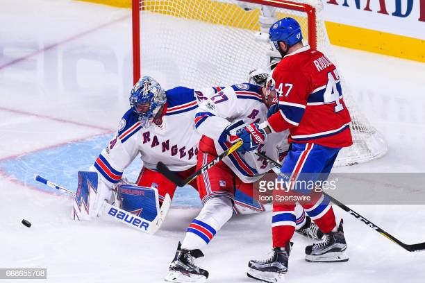 New York Rangers goalie Henrik Lundqvist stops the puck from a shot of Montreal Canadiens right wing Alexander Radulov during game 2 of the first...