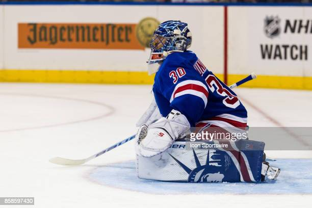New York Rangers Goalie Henrik Lundqvist stretches during a time out in the third period of the New York Rangers home opener against the Colorado...