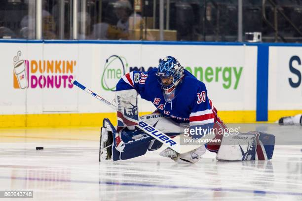 New York Rangers Goalie Henrik Lundqvist stretches on ice prior to the start of a regular season NHL game between the Pittsburgh Penguins and the New...