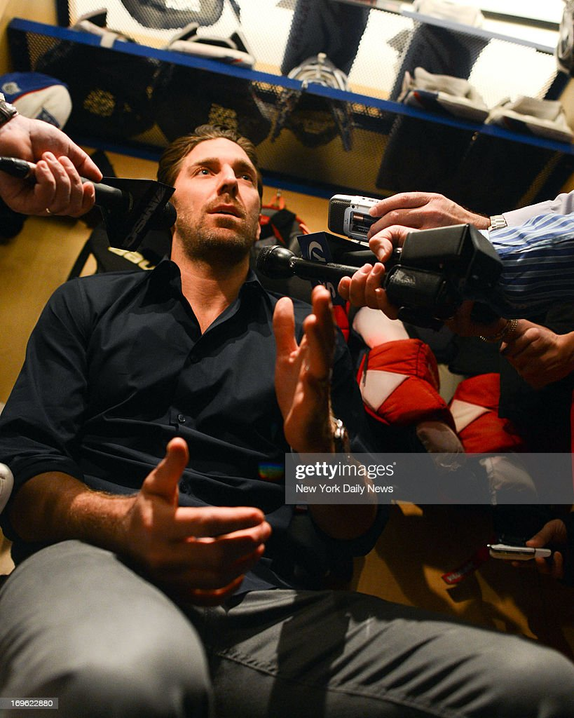 New York Rangers goalie Henrik Lundqvist (30) talks to the media at the practice facility after losing in the NHL playoffs to the Boston Bruins.