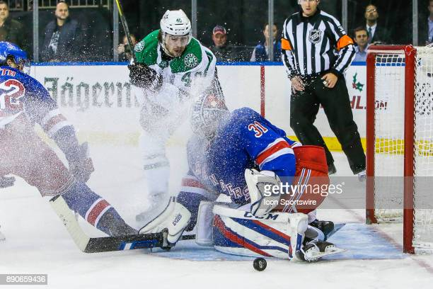 New York Rangers Goalie Ondrej Pavelec and Dallas Stars Left Wing Remi Elie track puck after shot and save during the Dallas Stars and New York...