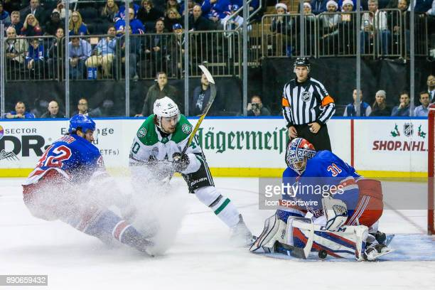 New York Rangers Goalie Ondrej Pavelec makes save on shot by Dallas Stars Left Wing Remi Elie as New York Rangers Defenseman Brendan Smith defends...