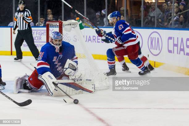 New York Rangers Goalie Ondrej Pavelec swats the puck away from the net during the third period of a regular season NHL game between the Florida...