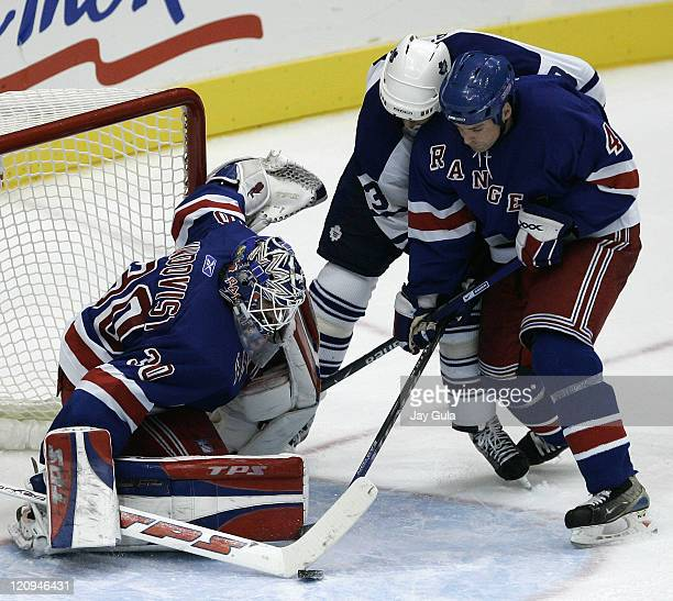 New York Rangers goaltender Henrik Lundquist makes a save on Toronto Maple Leafs Mats Sundin as teammate Aaron Ward helps out in action at the Air...