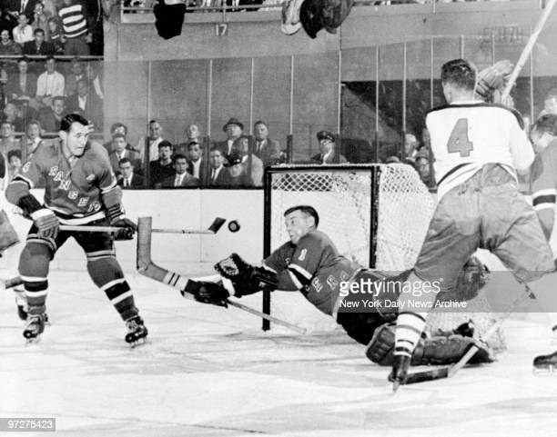 New York Rangers' Gump Worsley catching a puck in a game against Montreal