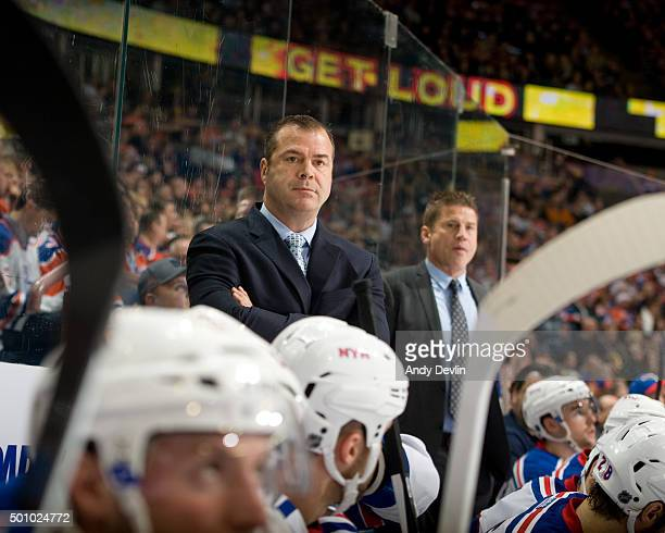 New York Rangers head coach Alain Vigneault stands behind the bench during his 1000th career NHL game during a game against the Edmonton Oilers on...