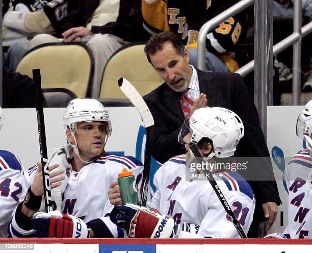 New York Rangers head coach John Tortorella talks with Marian Gaborik and Alexander Frolov during a game against the Pittsburgh Penguins at the...