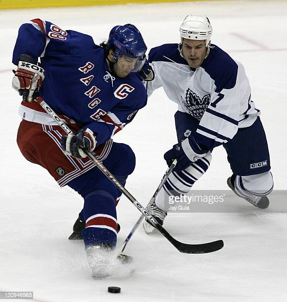 New York Rangers Jaromir Jagr and Toronto Maple Leafs Ian White battle for the puck in action at the Air Canada Centre in Toronto Canada October 21...