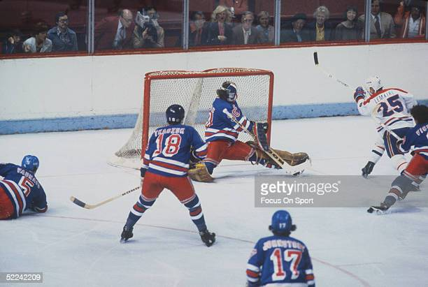 New York Rangers' John Davidson makes a save against the Montreal Canadiens' Jacques Lemaire at the Montreal Forum during the 197879 season in...