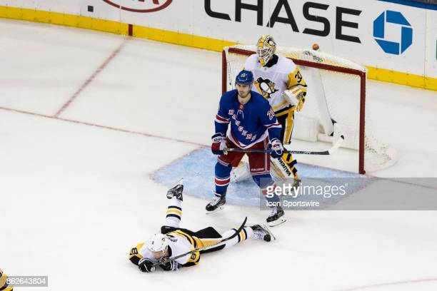 New York Rangers Left Wing Chris Kreider lays out Pittsburgh Penguins Defenceman Brian Dumoulin and gets called for cross checking during the second...