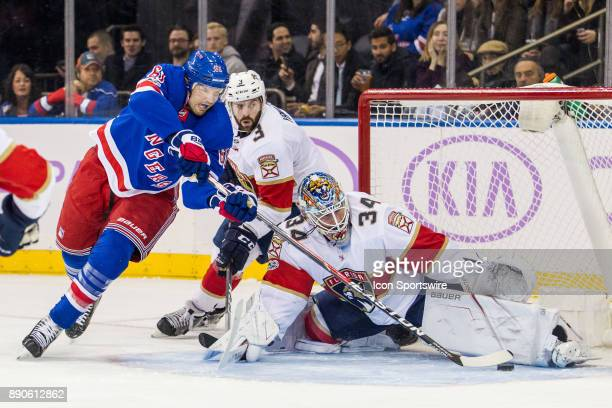 New York Rangers Left Wing Rick Nash reaches across the mouth of the net as Florida Panthers Goalie James Reimer makes the save during the first...